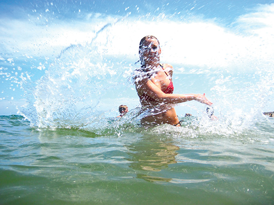 Girl plays in clear water