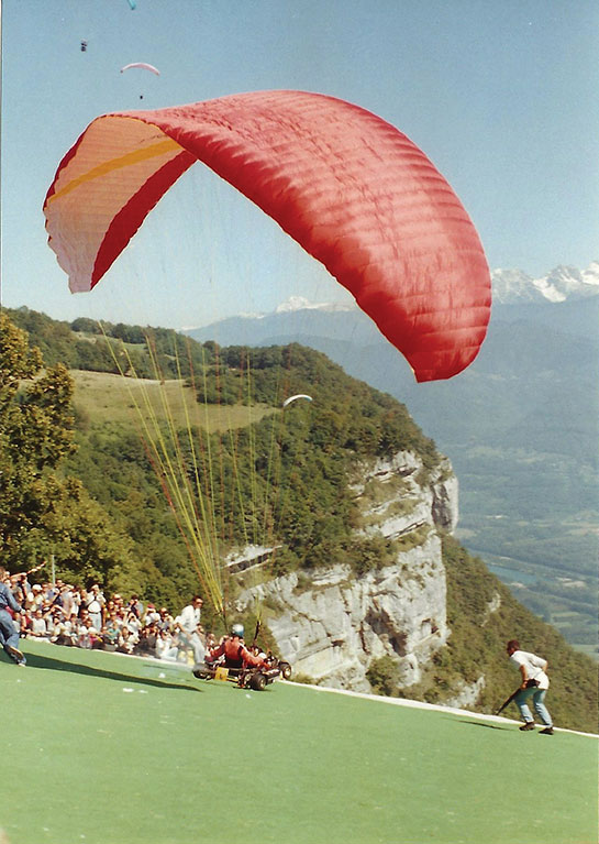 Old photo of paragliders