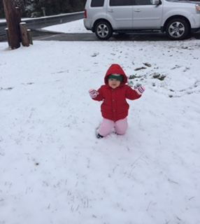 Child in snow in Kill Devil Hills