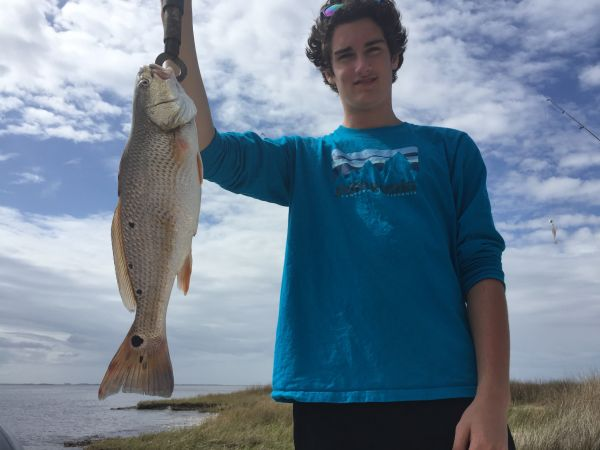 T-Time Charters, Forrest put a keeper redfish in the box